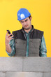 Builder reading a text message