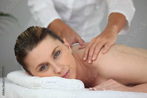 Woman having a back massage