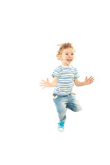 Jumping happy toddler boy