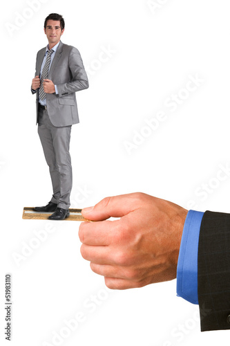 Businessman standing on someone else's credit card