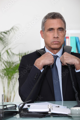 Businessman with two phones