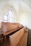 Wooden benches in Evangelical Lutheran Cathedral poster