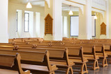 Row of wooden benches in Evangelical Lutheran Cathedral poster