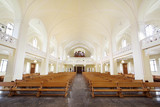 Rows of benches and organ in Evangelical Lutheran cathedral poster
