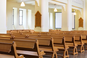 Row of wooden benches in Evangelical Lutheran Cathedral