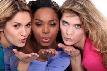 Female friends blowing kisses