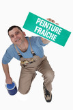 Man with a French wet paint sign