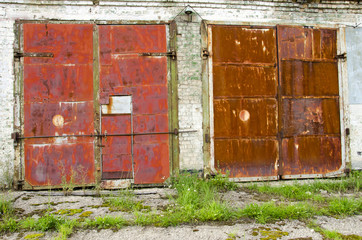 two old and rusted garage doors