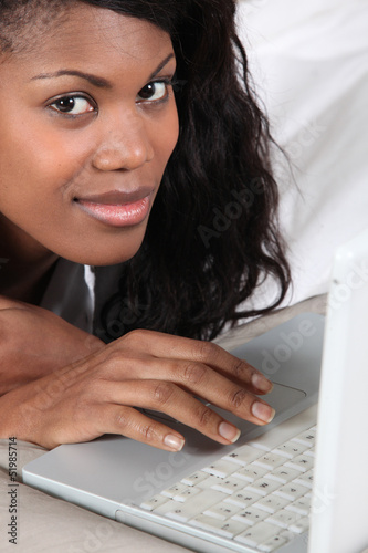 Afro-American woman using laptop