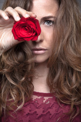 Beautiful fashion girl with red rose