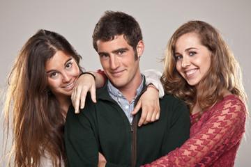 Three smart student friends looking camera