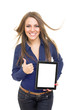 Cheerful female student showing tablet screen gesturing thumb up