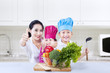 Chef vegetarian kids and mom give thumbs up at home