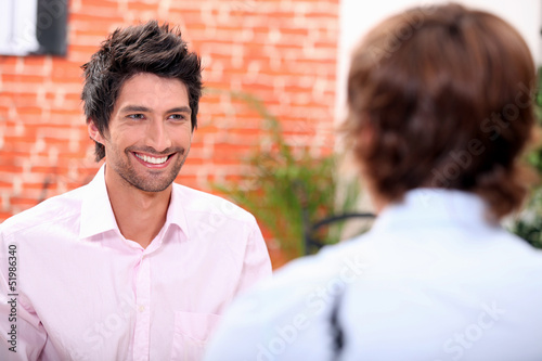 a man at restaurant with someone