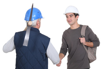 Construction worker with his trainee.