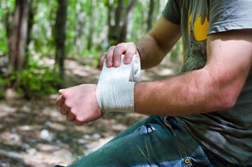 Applying an arm medical bandage