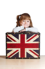 Pretty girl with a suitcase with British flag