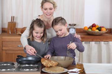 Mum and girls making pancakes
