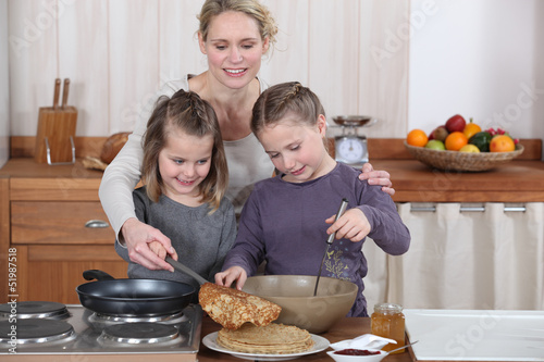 Mum and girls making pancakes