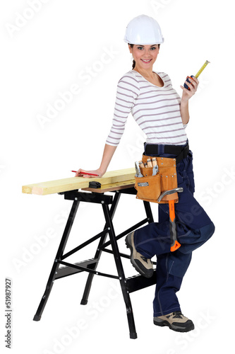 Female construction worker with a workbench