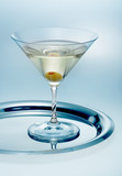 Glass of martini with olive
