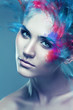 woman with flying coloured powder above eye