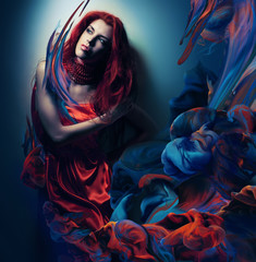 woman with red hair in paint waves