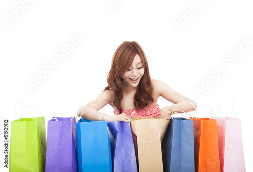 beautiful young woman open  shopping bags