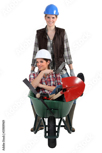 Woman being pushed in wheelbarrow