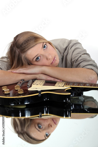 A cute blond with a guitar