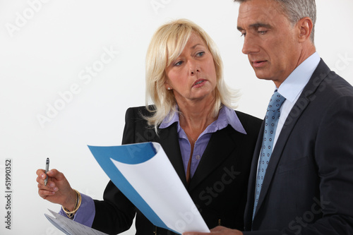 Experienced businessman people reviewing document