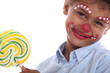 Boy made-up in clown with lollipop