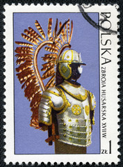 stamp printed in Poland shows the armor of the Polish cavalry