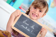 Little girl writing on chalkboard