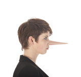 Young woman making a lie with long nose