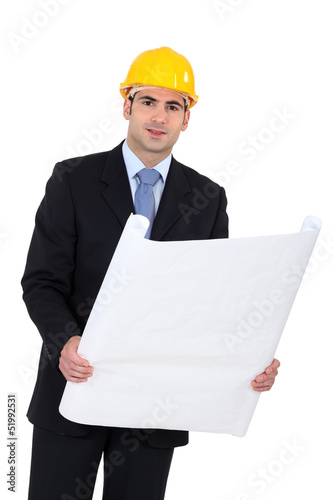 Architect in suit with blueprints