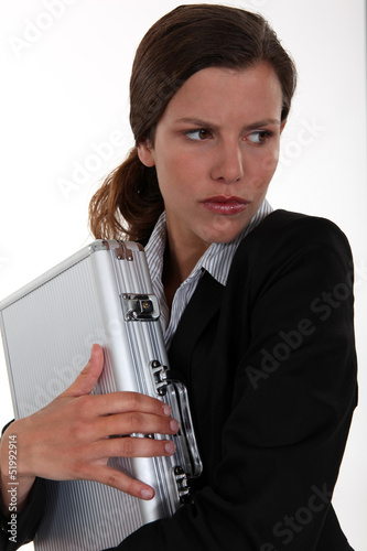 Woman protecting a briefcase