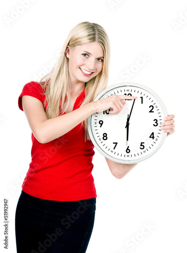 young woman with a clock isolated on white