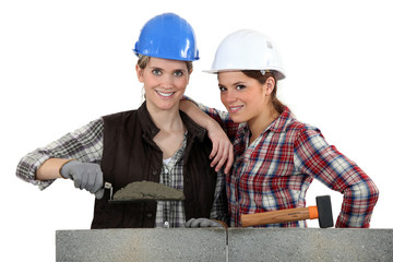 Women building wall