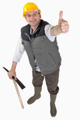 Delighted laborer with thumb up