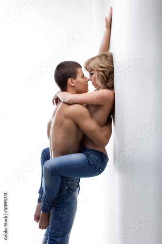 Young passionate couple of man and woman in studio