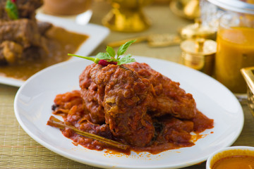 curry chicken cooked in indian style with spicy sauce and chilli