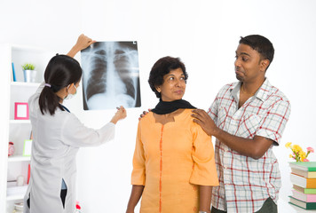 indian punjabi senior medical checkup with an asian female docto