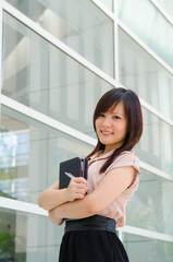 Asian female college student on campus background