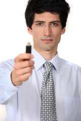 businessman holding a flash drive