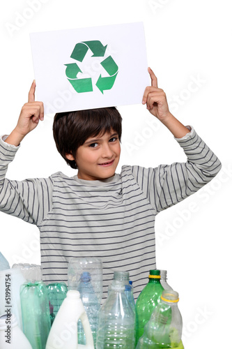 Small boy holding recycle logo