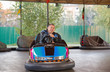 Senior man in small car at amusement park