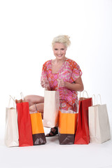 gorgeous blonde with shopping bags isolated on white