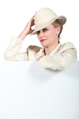 Woman holding hat