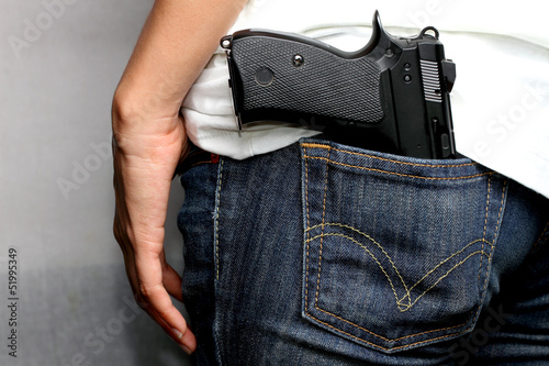 Gun in woman Jeans pocket